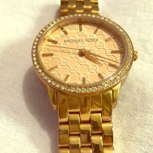 Micheal Kors rose gold watch.